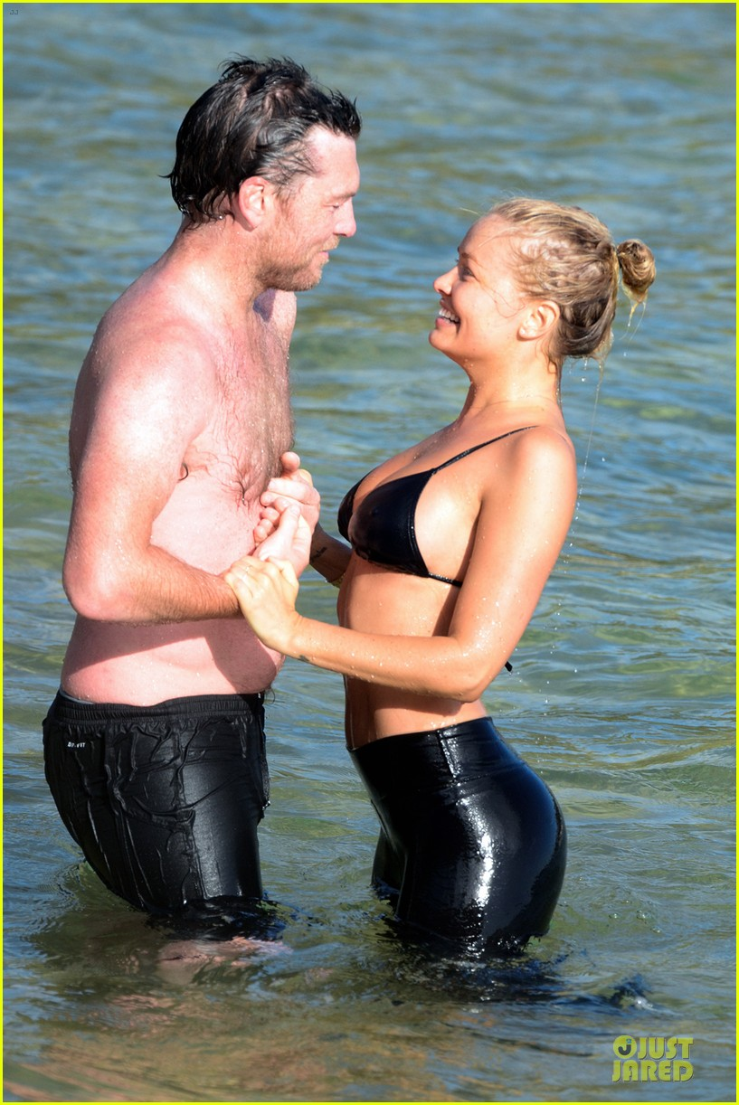 shirtless sam worthington laura bingle beach kissing couple 092969719