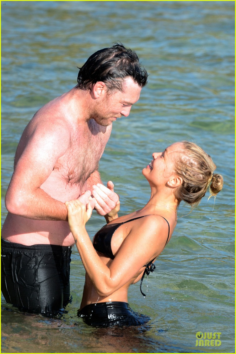 shirtless sam worthington laura bingle beach kissing couple 202969730