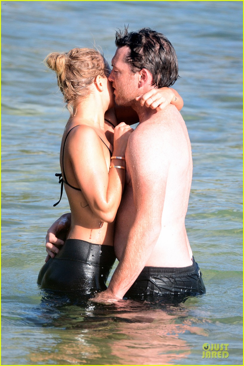 shirtless sam worthington laura bingle beach kissing couple 222969732
