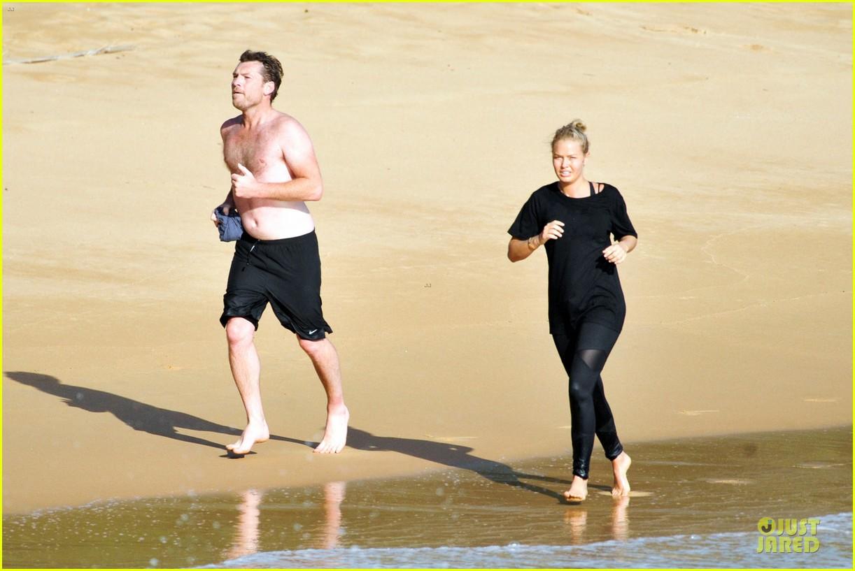 shirtless sam worthington laura bingle beach kissing couple 232969733