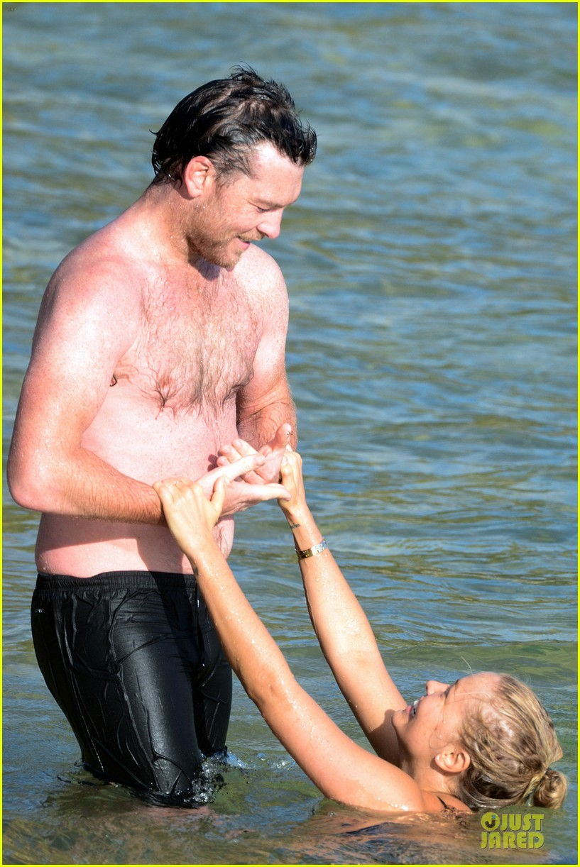 shirtless sam worthington laura bingle beach kissing couple 242969734