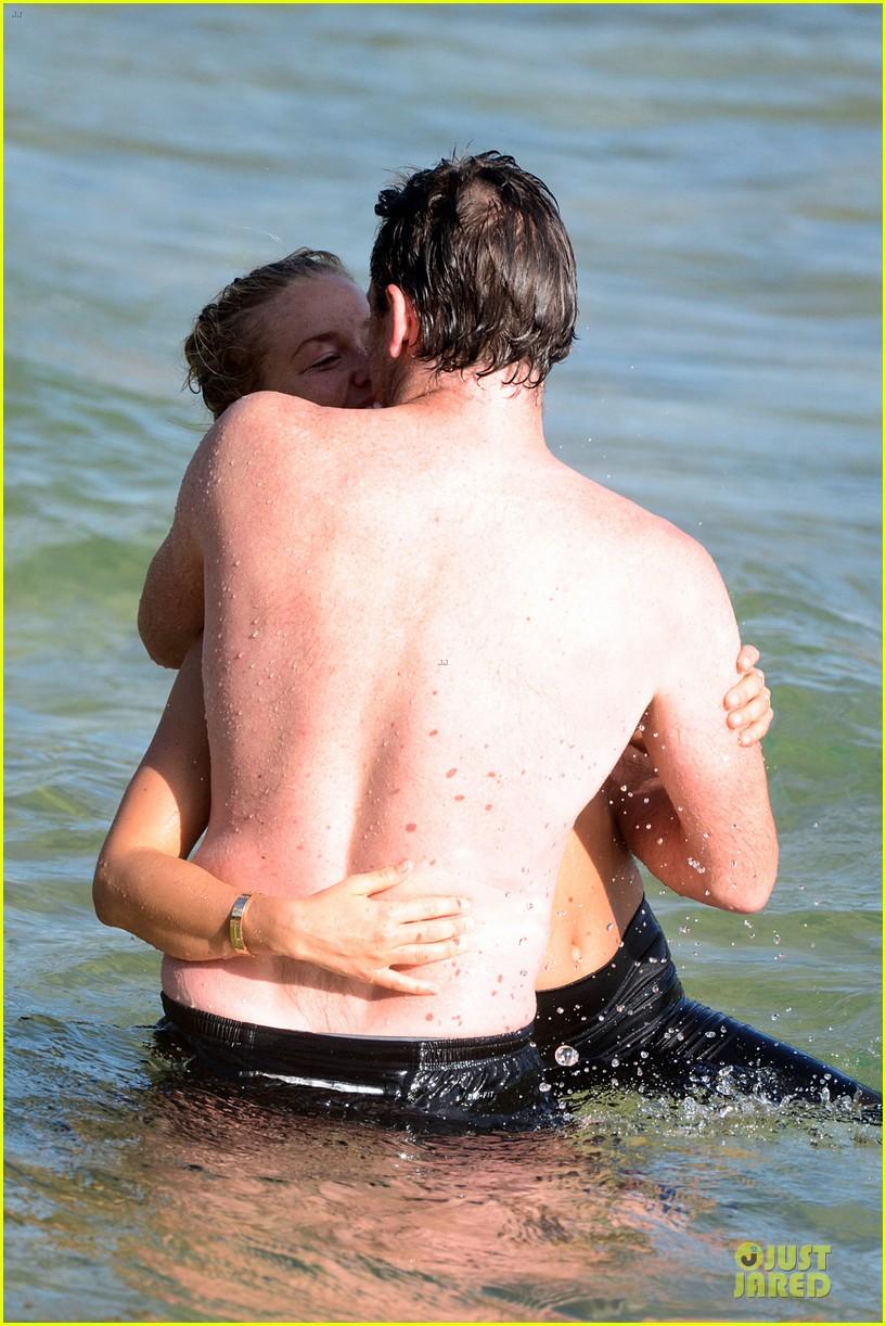 shirtless sam worthington laura bingle beach kissing couple 302969740
