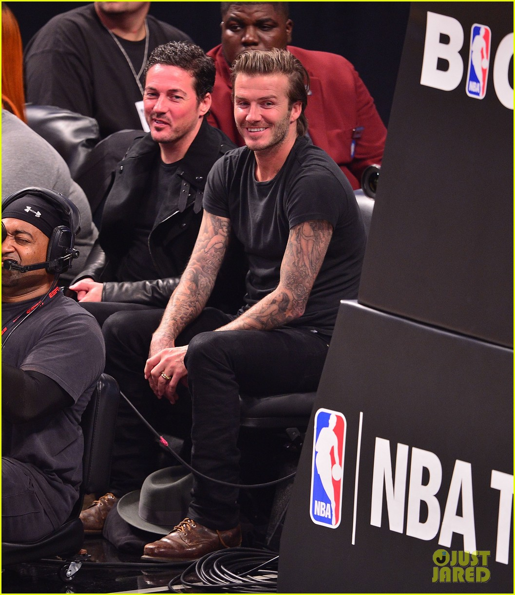 david beckham cheers on nets after flight into town 03