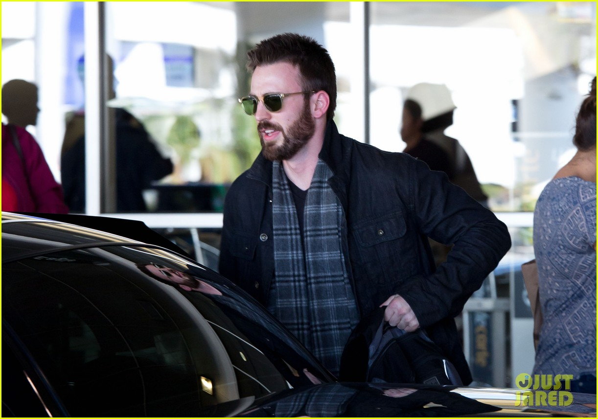 chris evans steps out after split from minka kelly 042989633