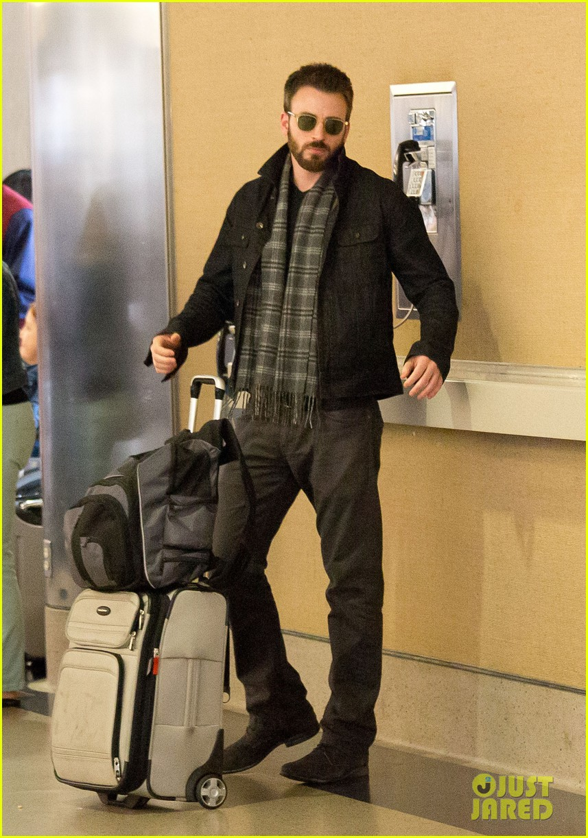 chris evans steps out after split from minka kelly 052989634
