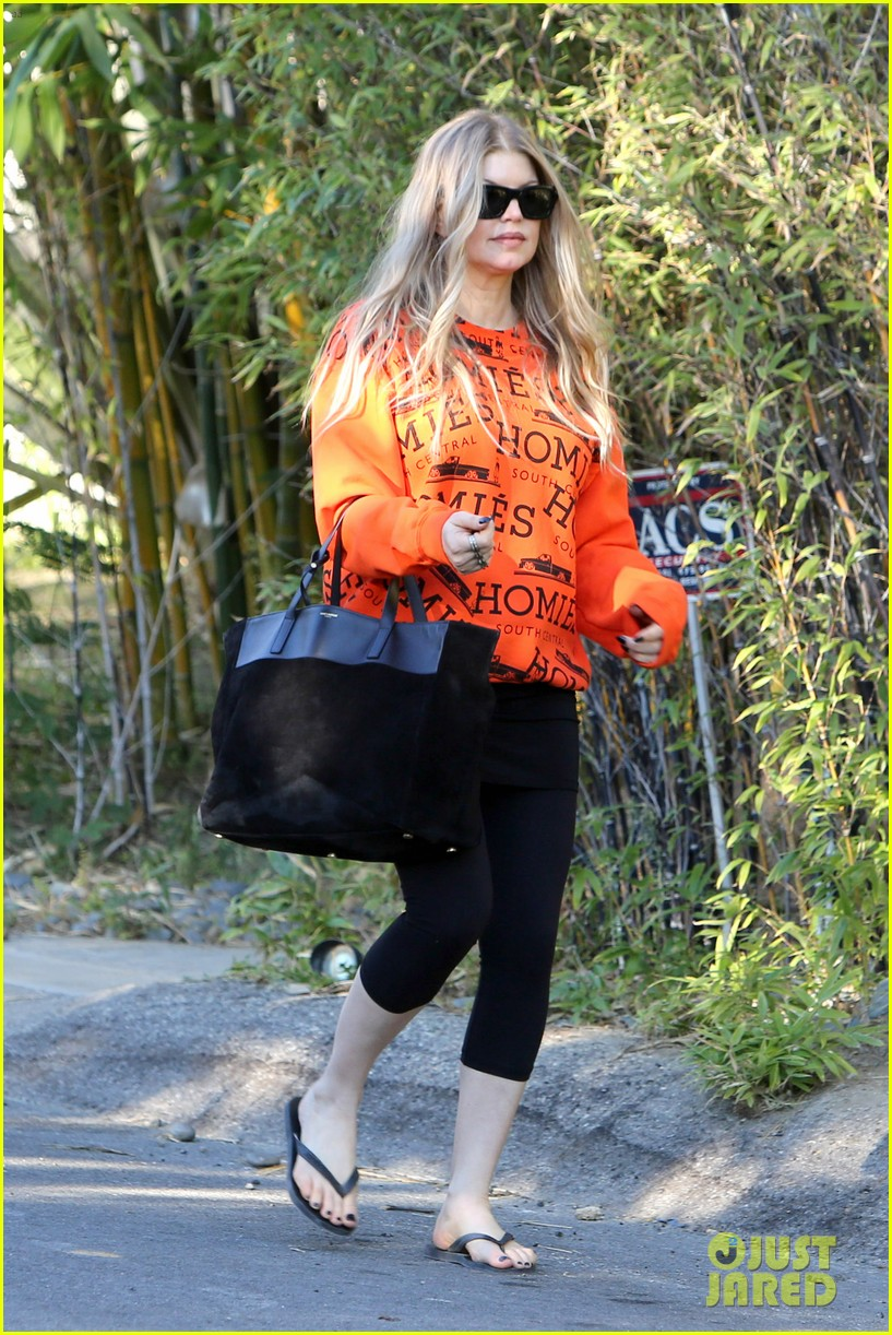 fergie halloween festive in orange sweatshirt 01