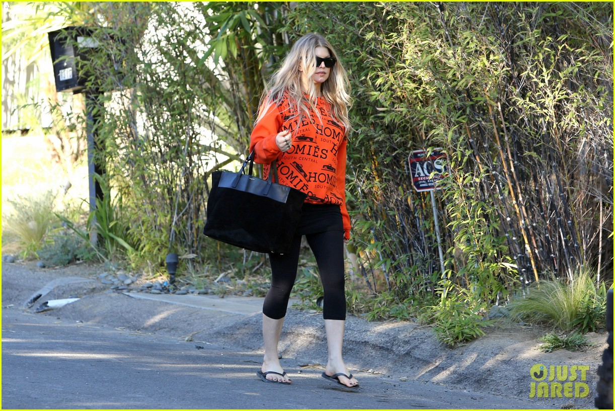 fergie halloween festive in orange sweatshirt 09