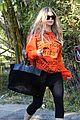 fergie halloween festive in orange sweatshirt 06