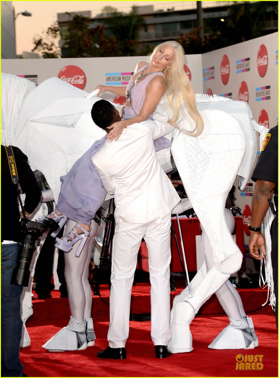 lady gaga rides horse on amas 2013 red carpet 082999323