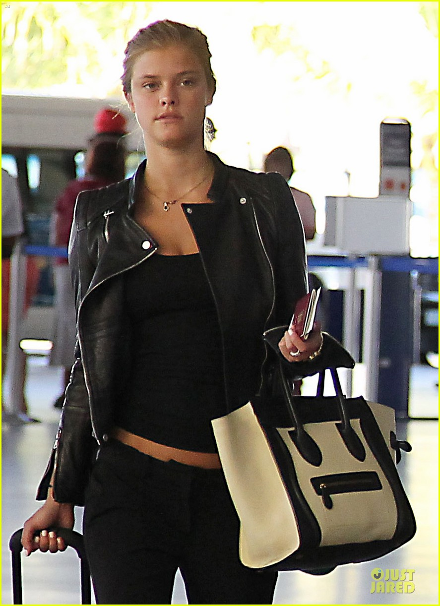 max george nina agdal goodbye kiss at barbados airport 023002538
