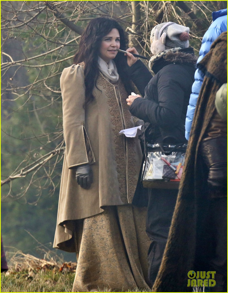 ginnifer goodwin cradles baby bump kisses josh dallas on set 053002075