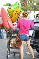 ashley greene leaves store with balloons party supplies 11