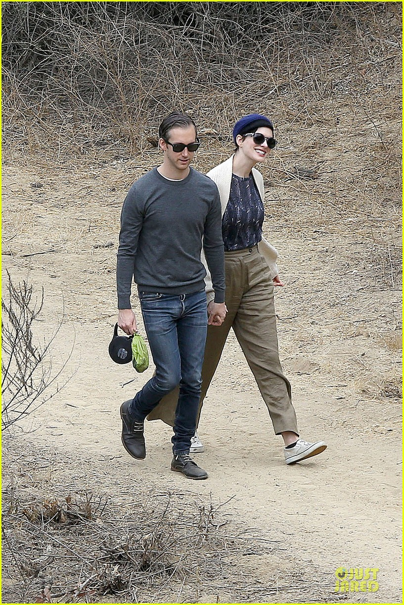 anne hathaway adam shulman hold hands for intimate walk 202994288