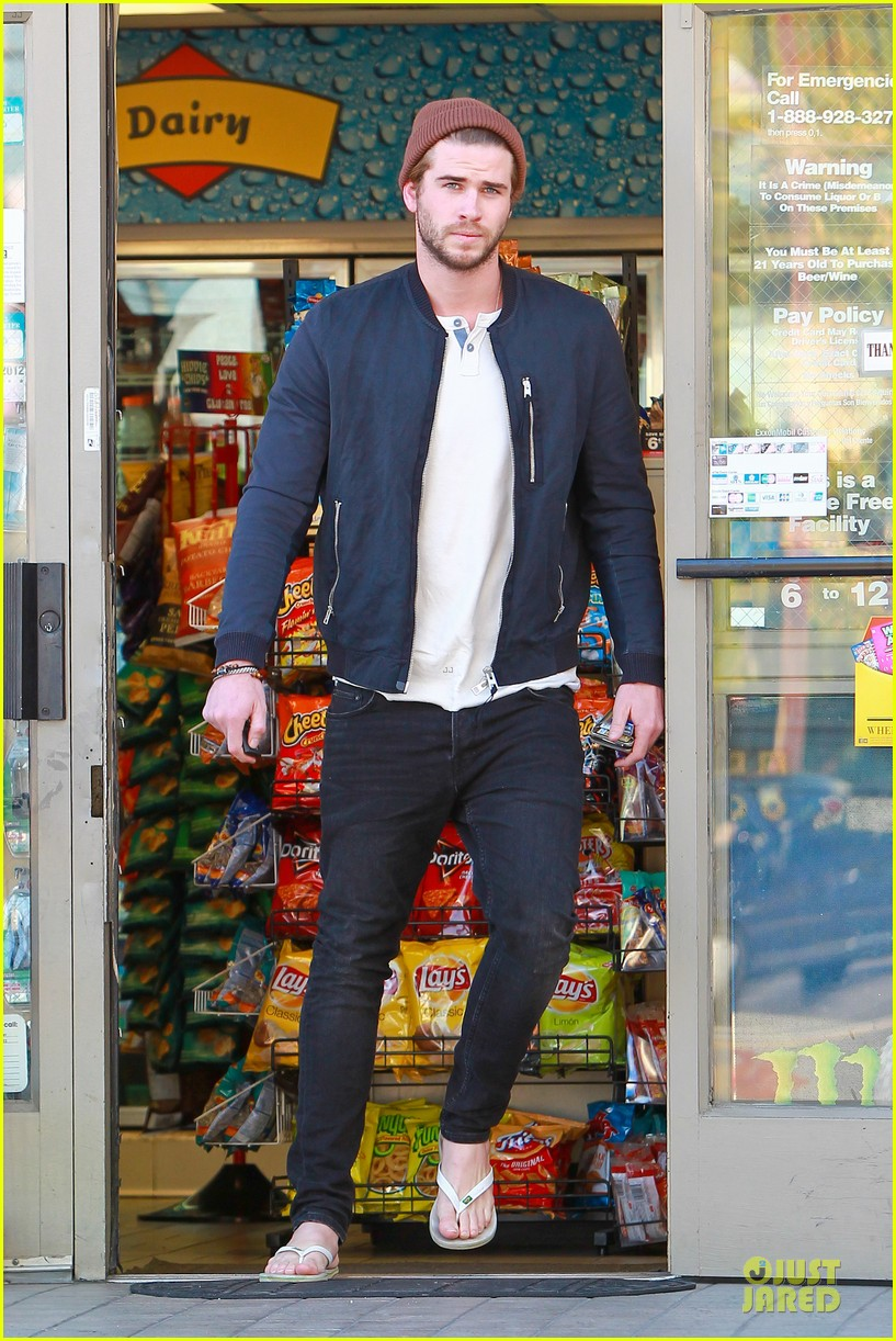 liam hemsworth steps out after catching fire breaks box office record 033000200