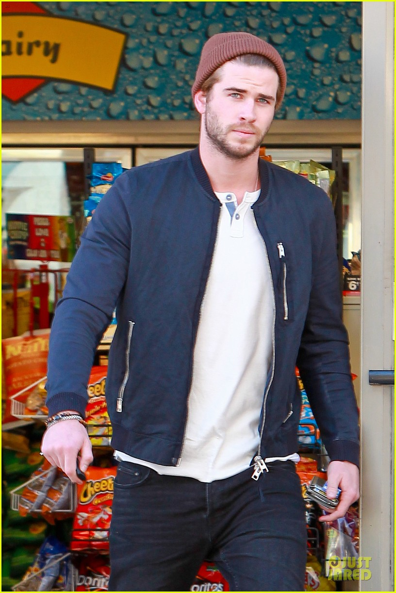 liam hemsworth steps out after catching fire breaks box office record 043000201