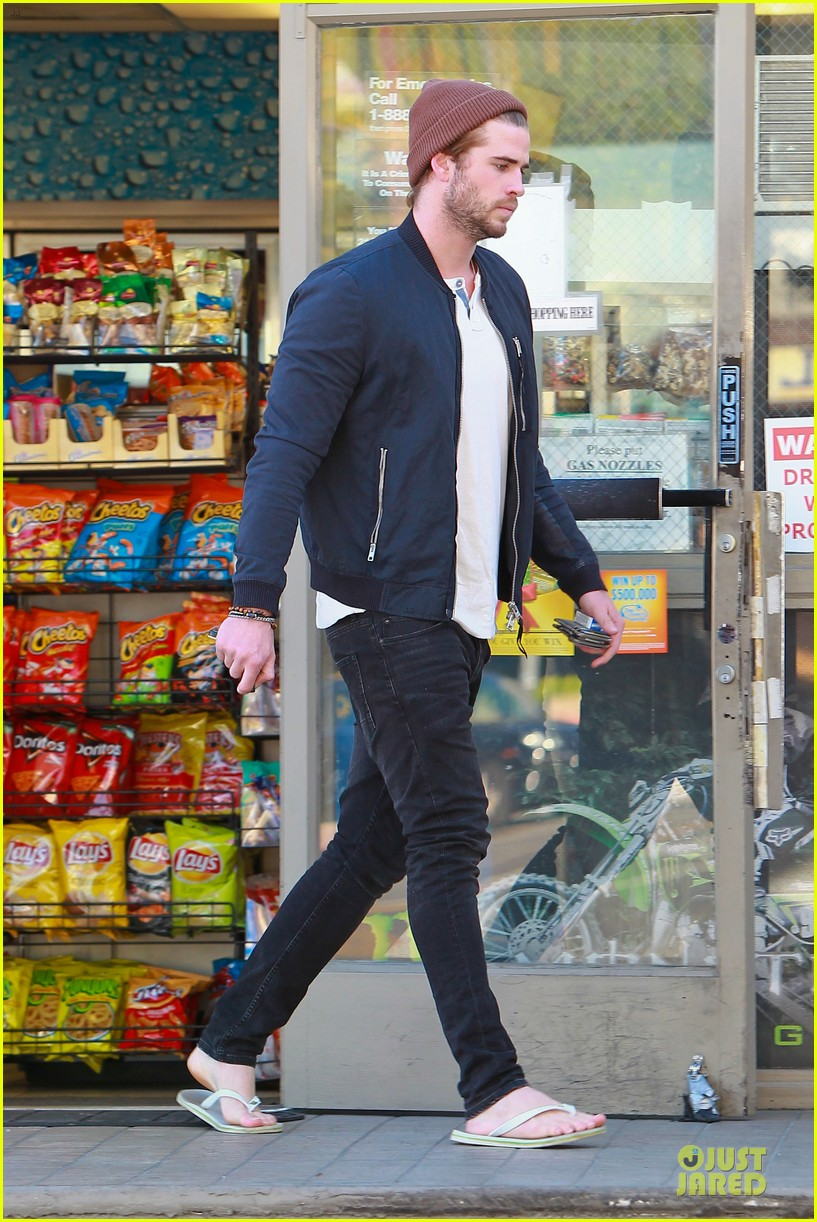 liam hemsworth steps out after catching fire breaks box office record 083000205