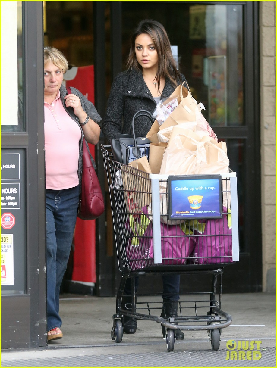 mila kunis shops amidst ashton kutchers walmart feud 182997303