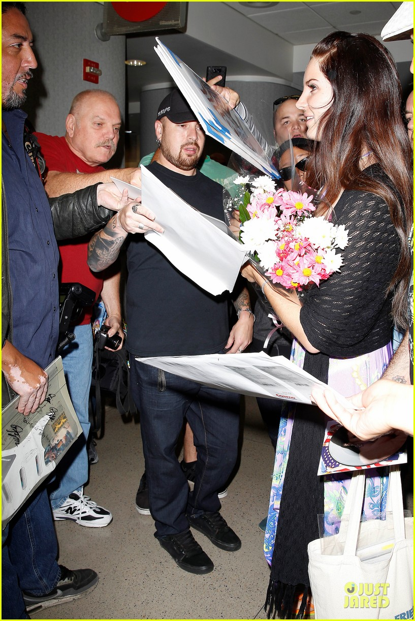 lana del rey receives flowers at lax airport 122994219