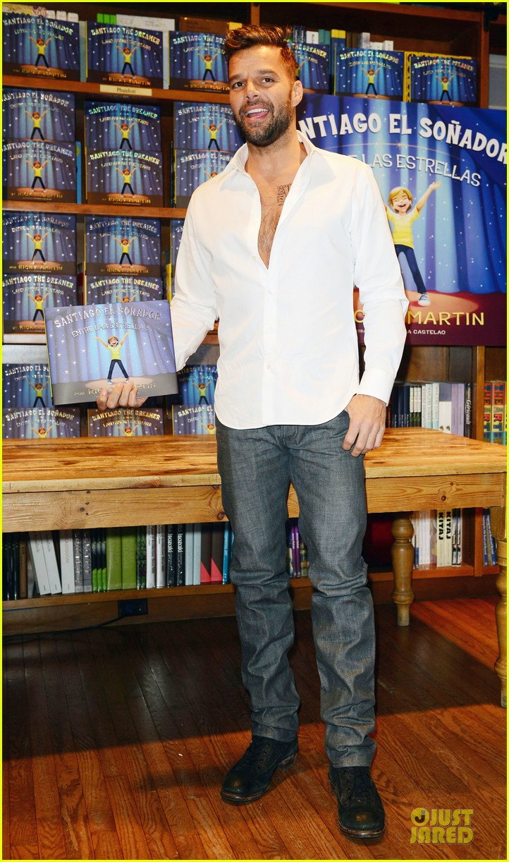ricky martin flashes chest hair for santiago signing 01