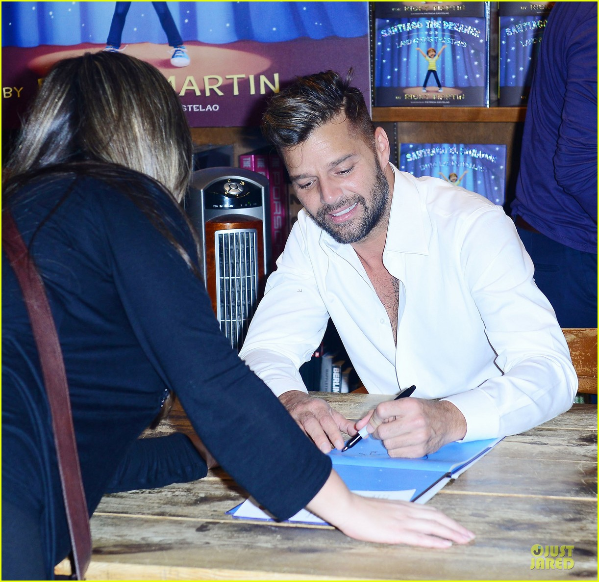 ricky martin flashes chest hair for santiago signing 022994114