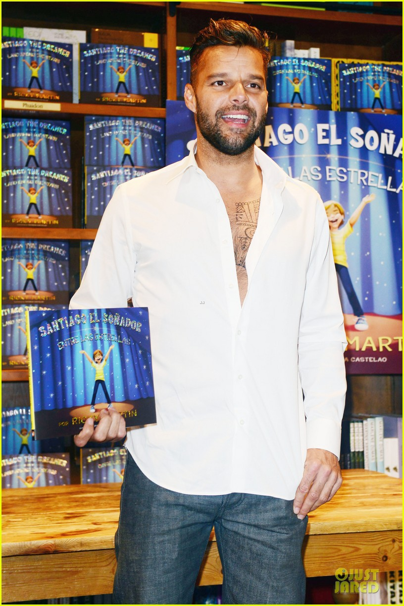 ricky martin flashes chest hair for santiago signing 06