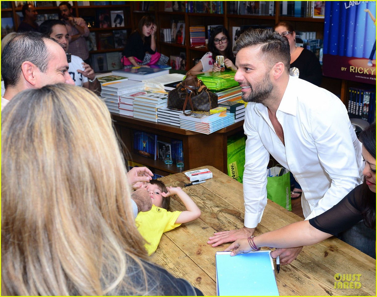 ricky martin flashes chest hair for santiago signing 102994122