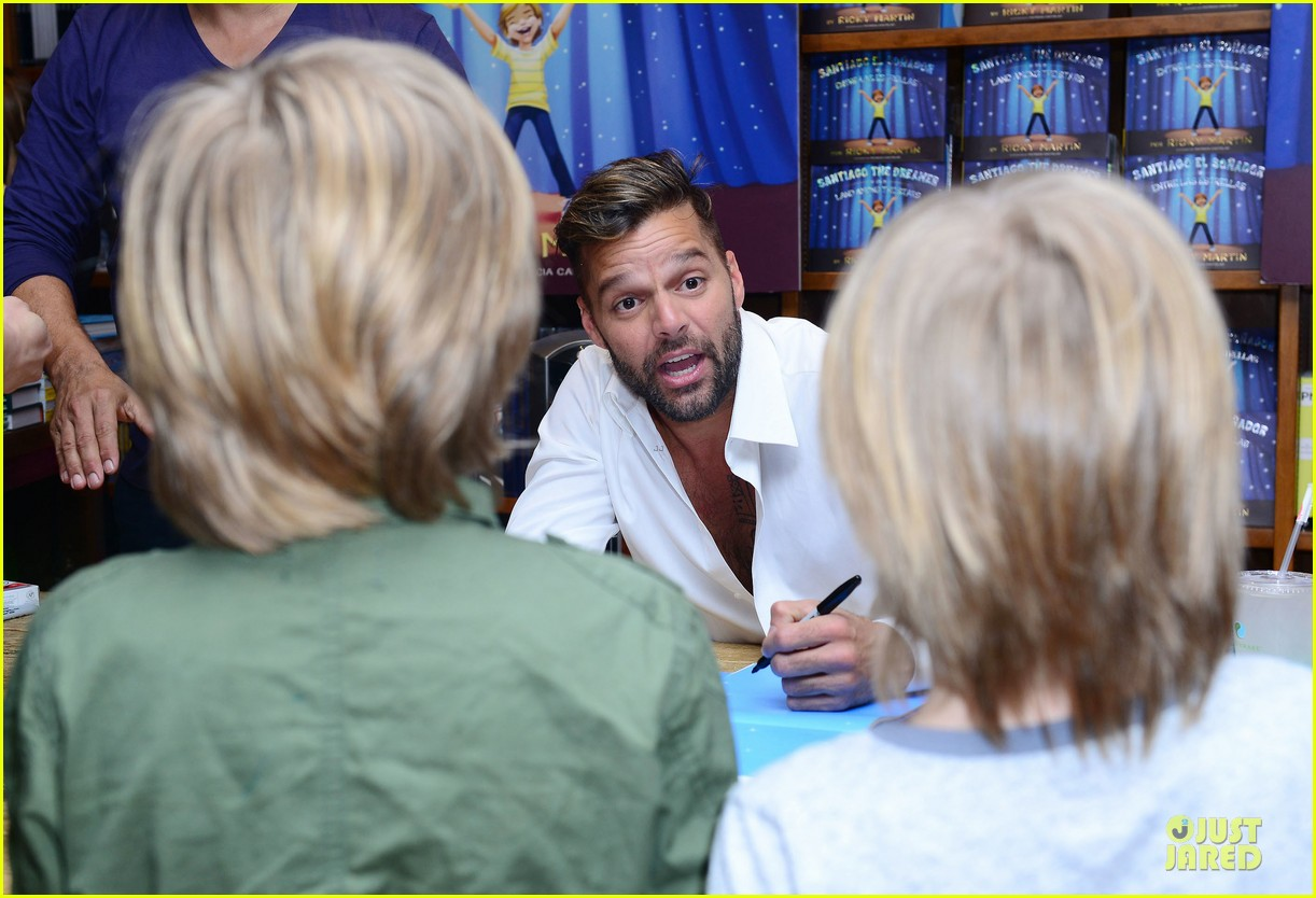ricky martin flashes chest hair for santiago signing 13