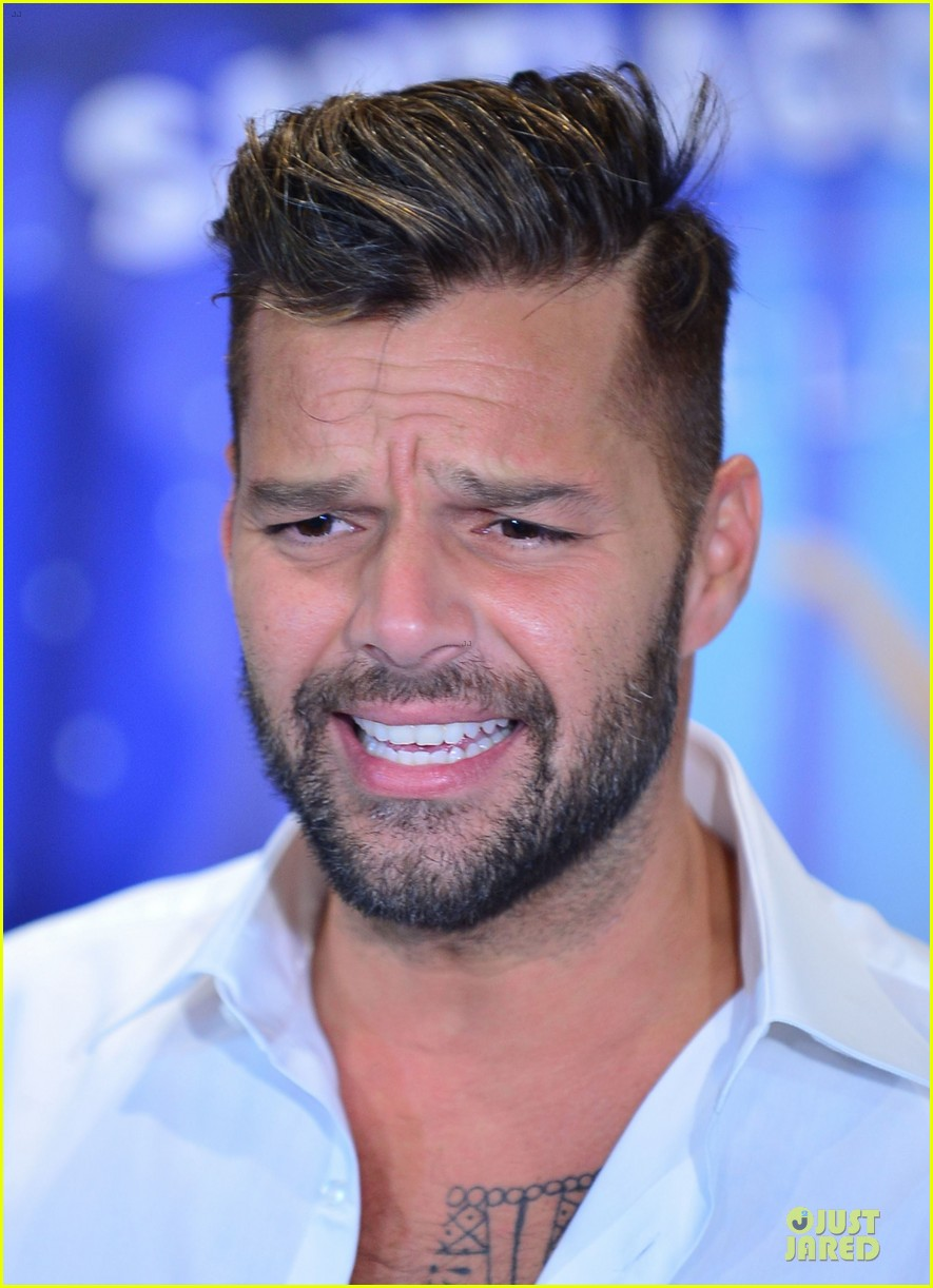 ricky martin flashes chest hair for santiago signing 142994126
