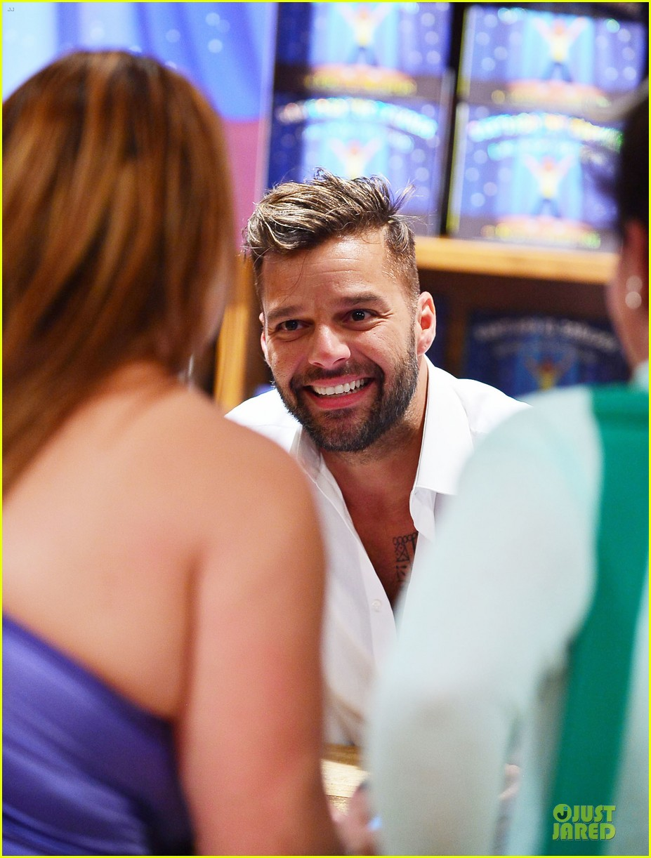 ricky martin flashes chest hair for santiago signing 192994131