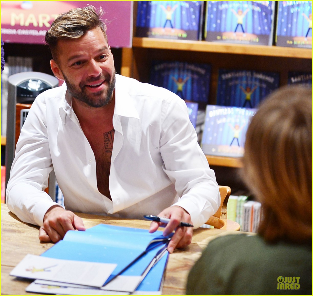 ricky martin flashes chest hair for santiago signing 202994132