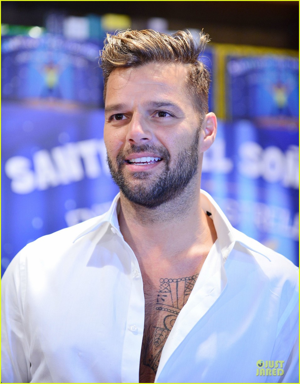 ricky martin flashes chest hair for santiago signing 212994133