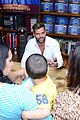 ricky martin flashes chest hair for santiago signing 05