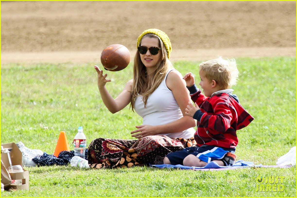 teresa palmer dives for ball during family football game 02