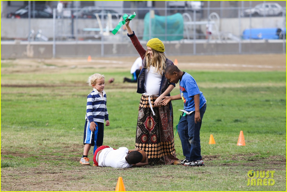 teresa palmer dives for ball during family football game 052998771