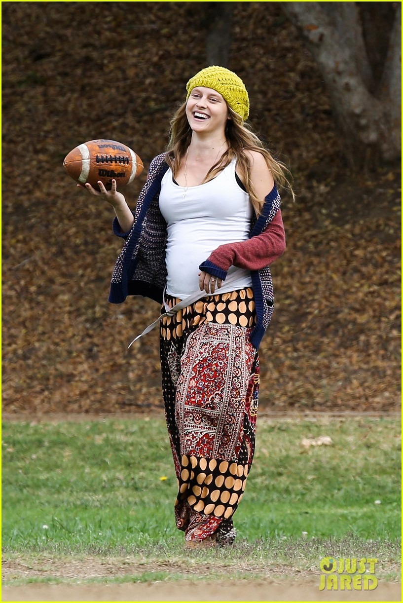 teresa palmer dives for ball during family football game 092998775
