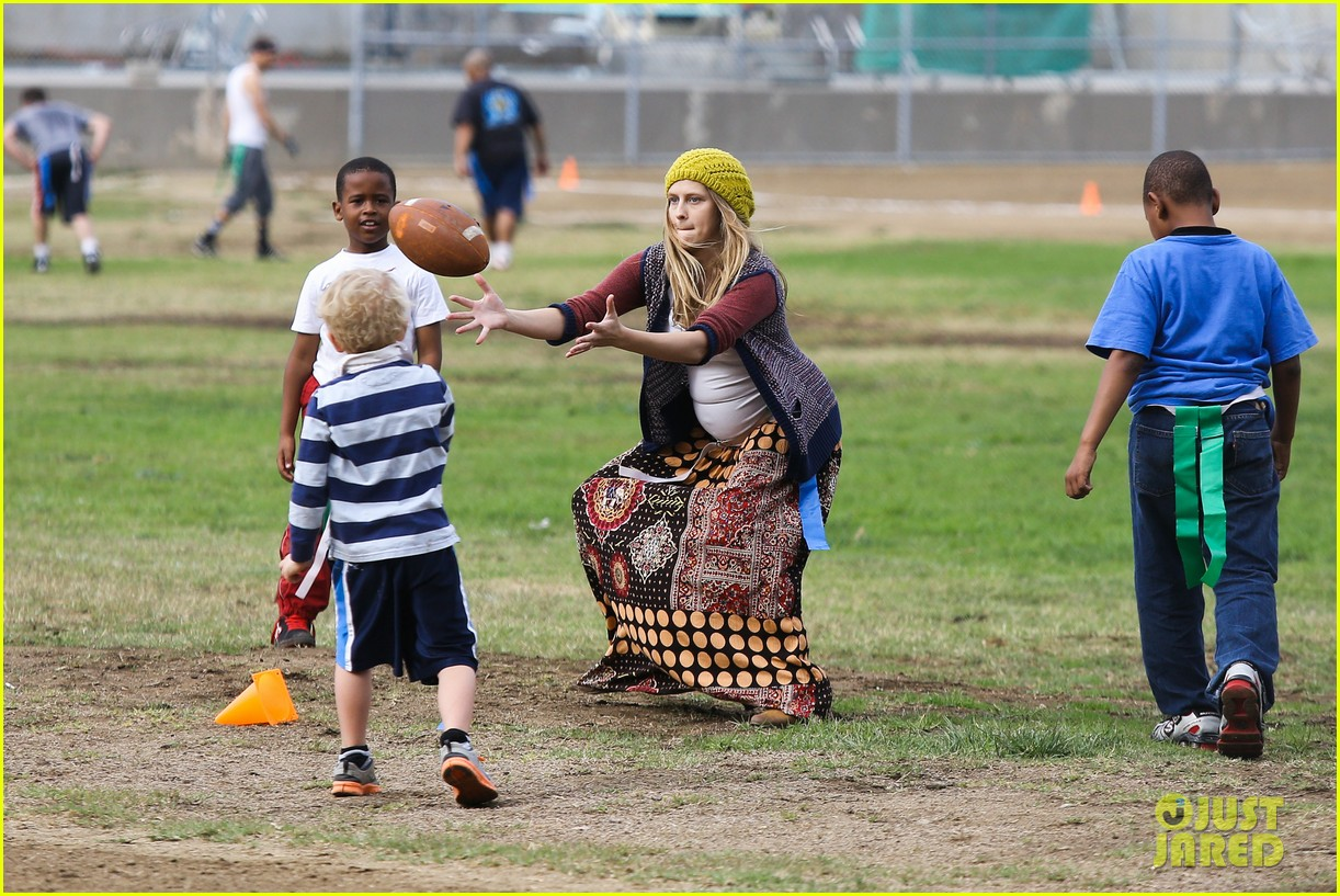 teresa palmer dives for ball during family football game 172998783