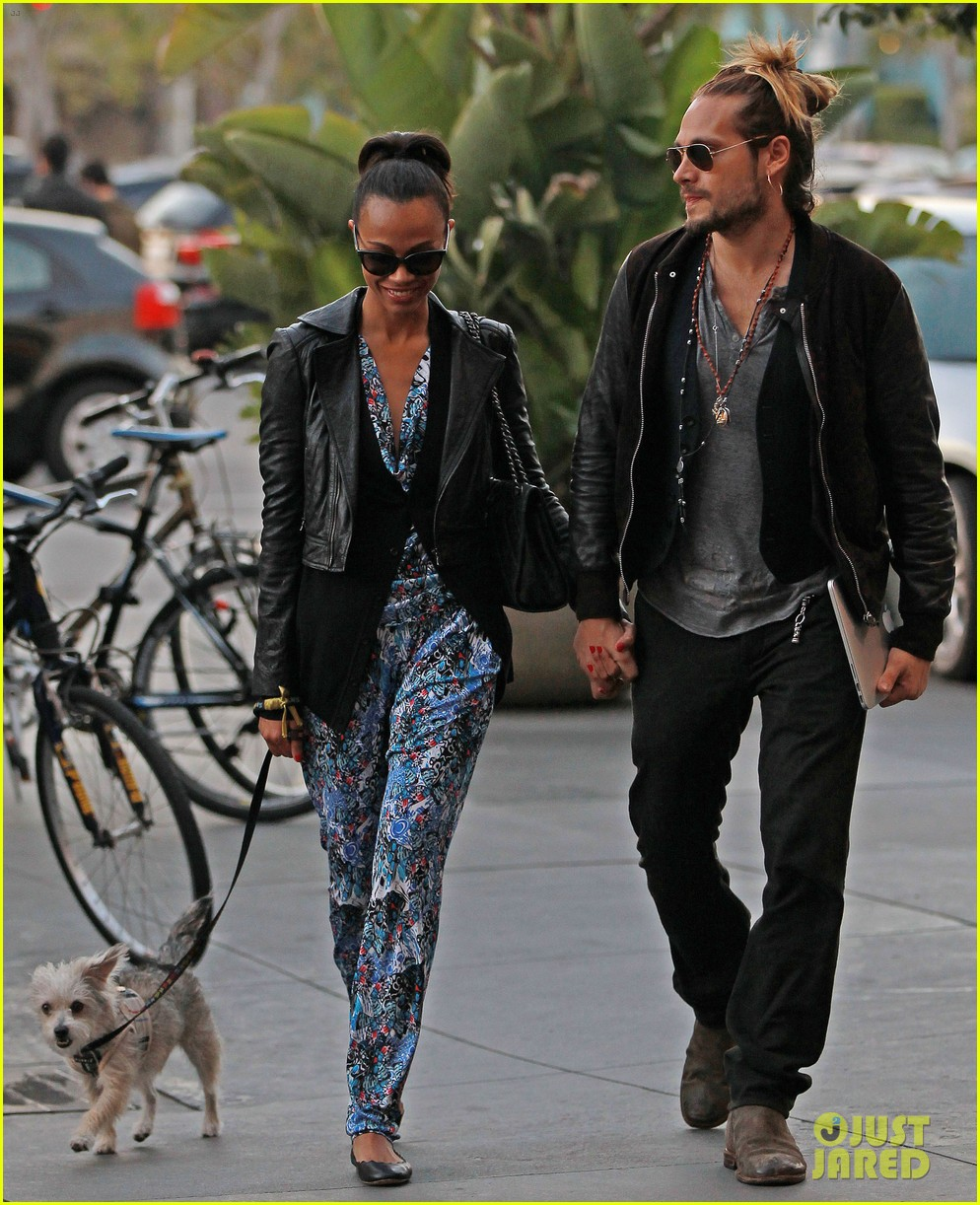 zoe saldana marco perego hold hands look so in love 122984001