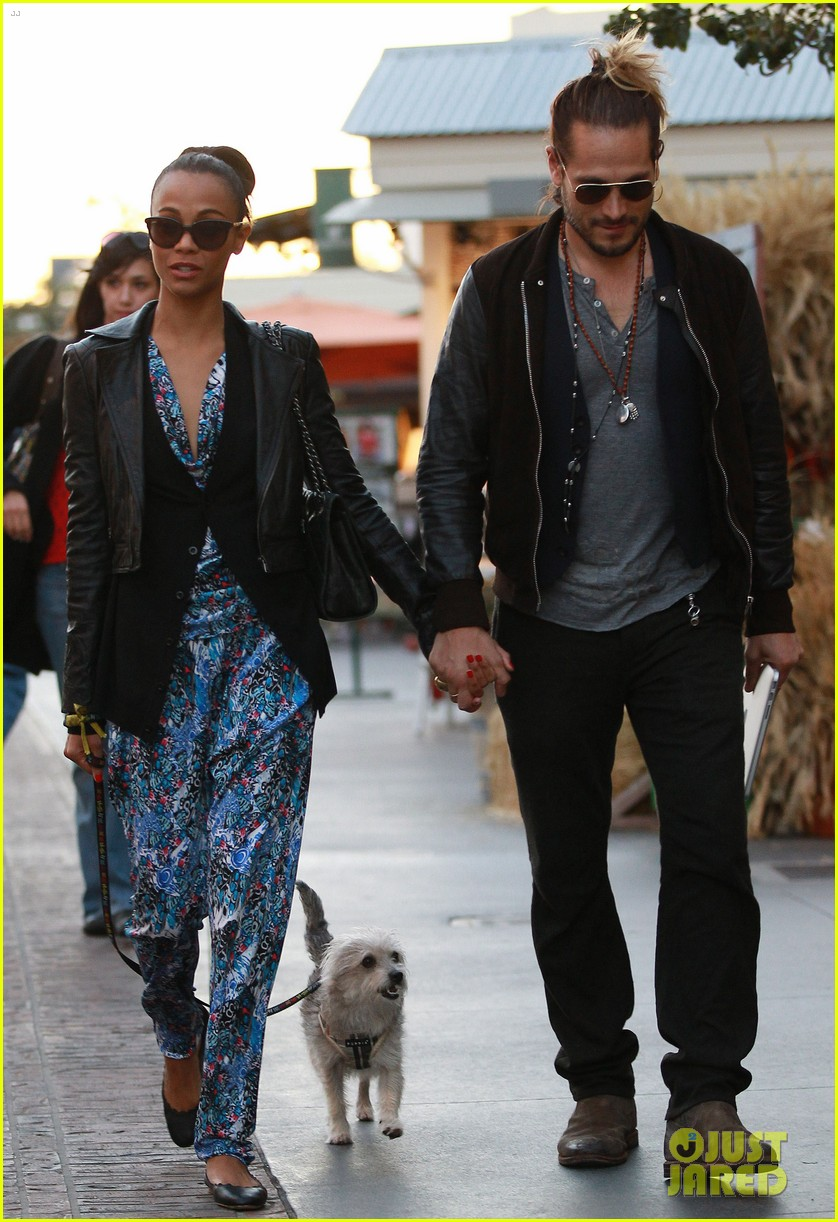 zoe saldana marco perego hold hands look so in love 182984007