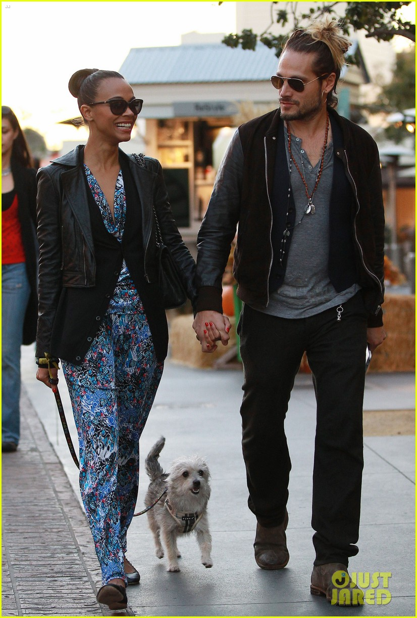 zoe saldana marco perego hold hands look so in love 202984009