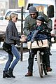 naomi watts straps in boys for bike ride with liev schreiber 11