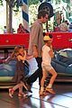 ben affleck rides bumper cars at disneyland with his girls 01
