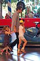 ben affleck rides bumper cars at disneyland with his girls 06