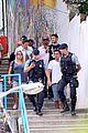 josh bowman promotes john john on brazilian favela visit 10