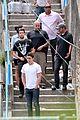 josh bowman promotes john john on brazilian favela visit 14