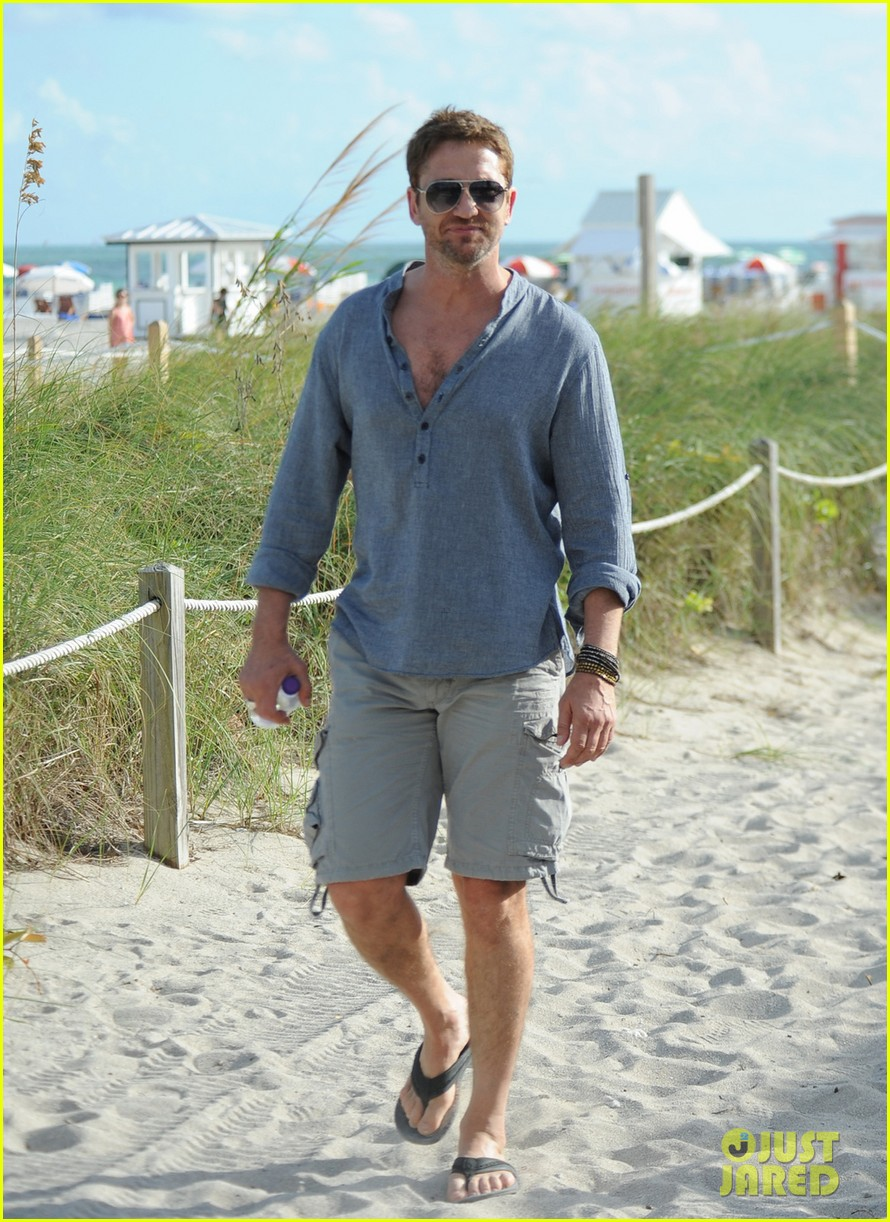 gerard butler enjoys beach time during art basel 04