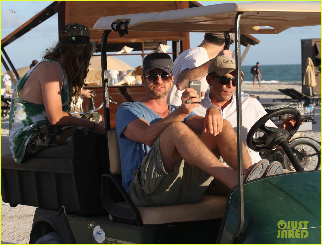 gerard butler kicks back takes photos during golf cart ride 02