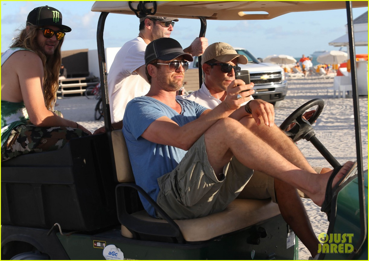gerard butler kicks back takes photos during golf cart ride 193006675