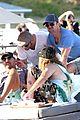 gerard butler kicks back takes photos during golf cart ride 14