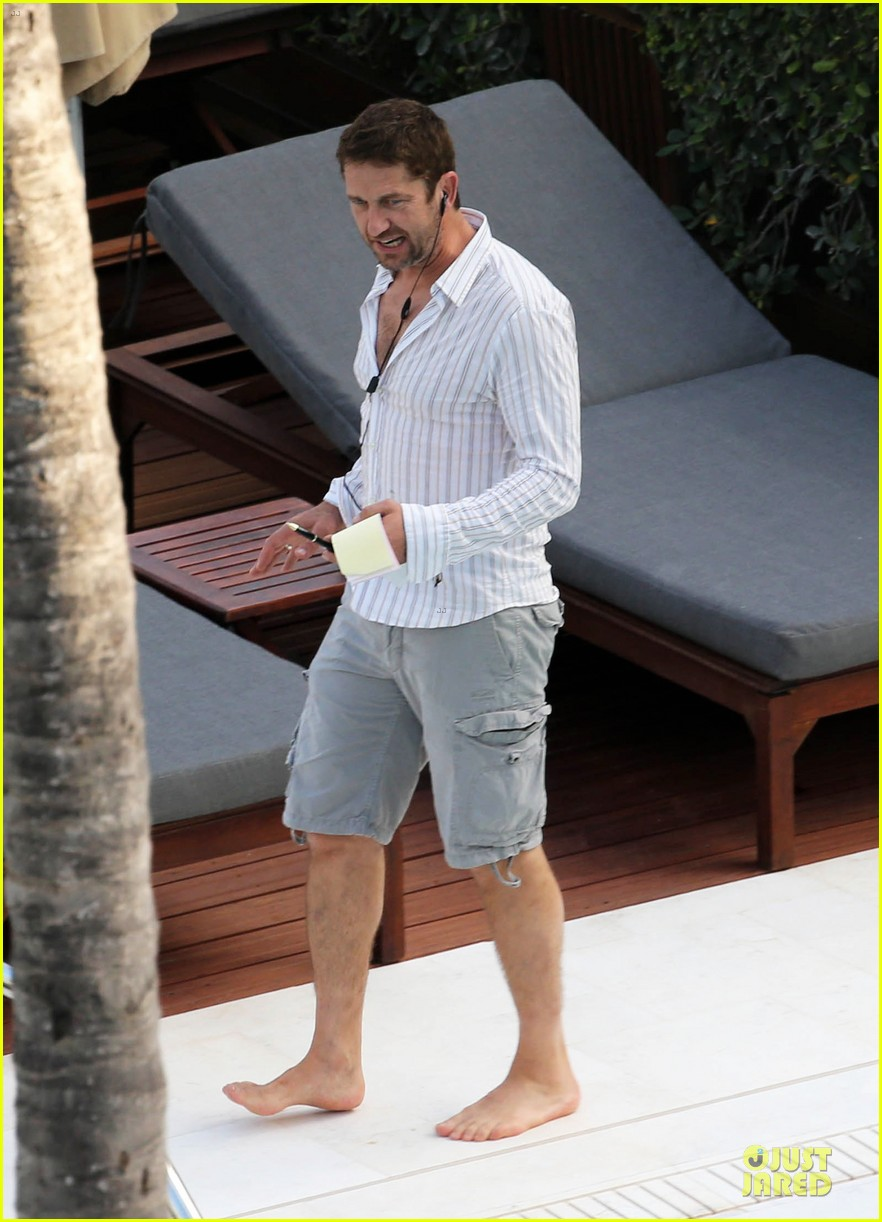 gerard butler relaxes at miami hotel pool with friends 133004336