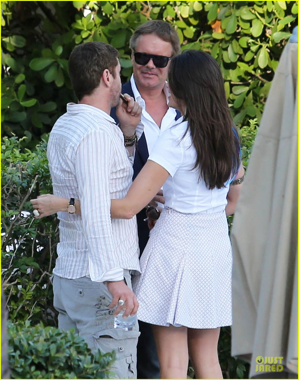 gerard butler relaxes at miami hotel pool with friends 213004344